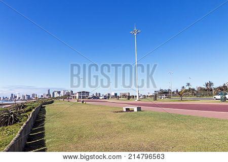 Beachfront Promenade Against Blue Durban City Skyline