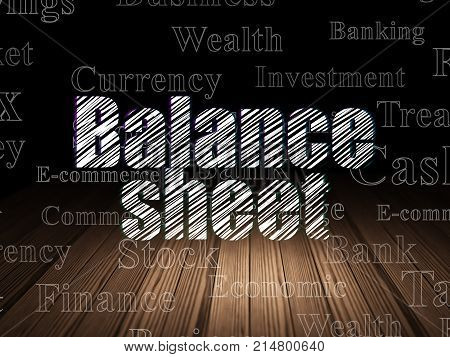 Banking concept: Glowing text Balance Sheet in grunge dark room with Wooden Floor, black background with  Tag Cloud