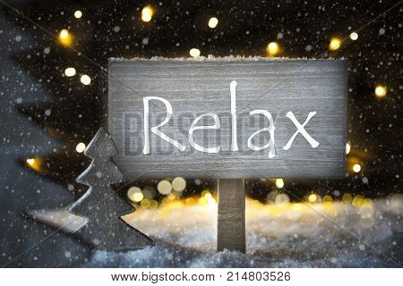 Sign With English Text Relax. White Christmas Tree With Snow And Magic Glowing Lights In Backround And Snowflakes. Card For Seasons Greetings.