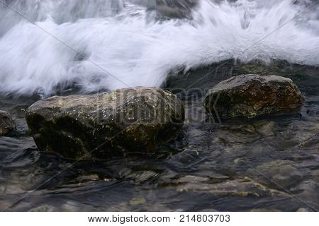 Wave coming to the rock in the sea