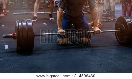 Close Up On Muscular Man Preparing To Weightlifting