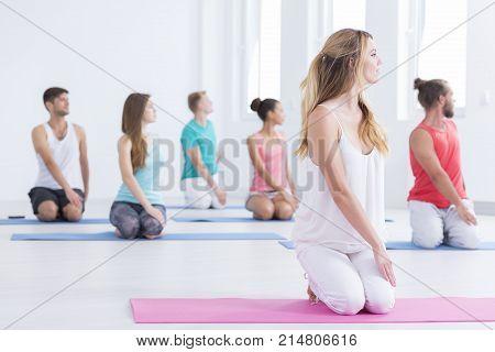 Men And Women Doing Yoga