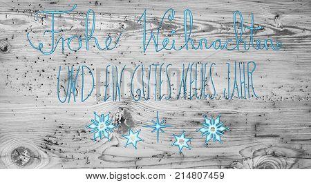 Turquoise German Calligraphy Frohe Weihnachten Und Ein Gutes Neues Jahr Means Merry Christmas And Happy New Year. Gray Vintage Wooden Background