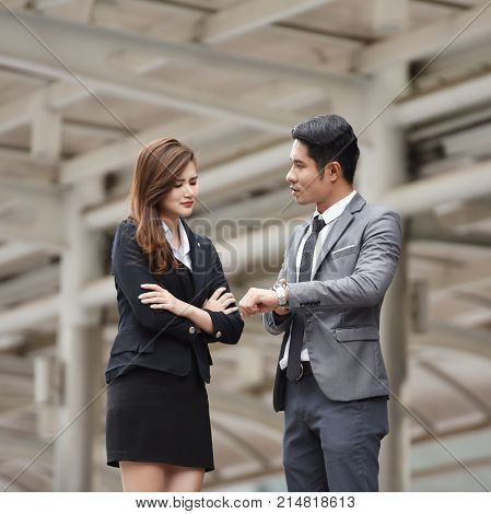 Furious boss scolding young Business woman. Late.