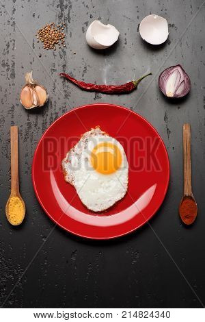 Omelet And Eggshells, Garlic, Chili Pepper And Onion Placed Around