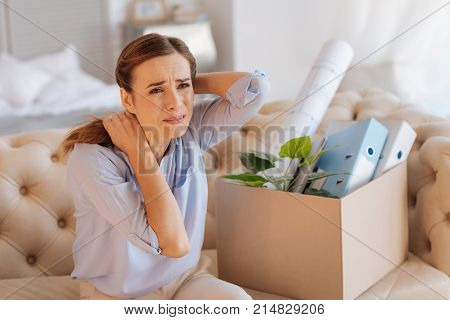 Desperate. Expressive sensitive emotional woman not hiding her feelings and crying after losing her job while being alone in her flat
