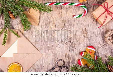 Christmas decoration with a tree chic gingerbread man gift envelope candy cane and scissors. Preparing for Christmas. Gift wrapping. Copy space