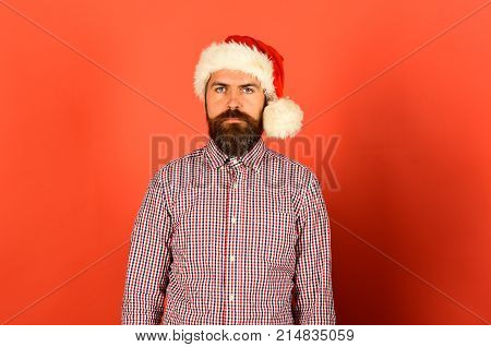 Christmas Time Concept. Man With Serious Face On Red Background