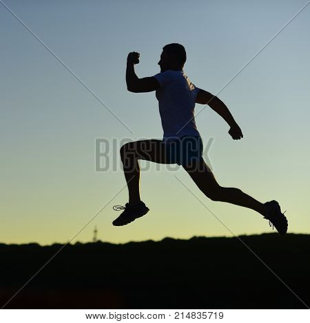 Sport And Training Concept. Sportsman Jogging In Evening.