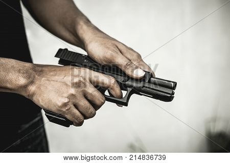 A man holding a gun in hand the ship ready to shoot the man pointed a gun at us. A man holding a gun was robbed.