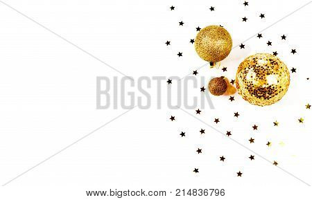 a pattern of golden christmas balls and stars from aboveFlat lay, top view