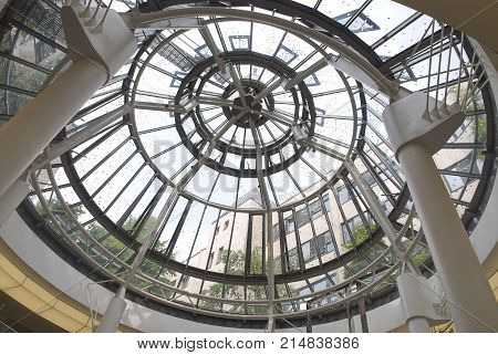 DUSSELDORF, GERMANY, JUN.13, 2010: Modern round metal and glass dome cupola. Abstract architecture element. Architectural elements parts details metal glass dome. Inside interior view on glass dome