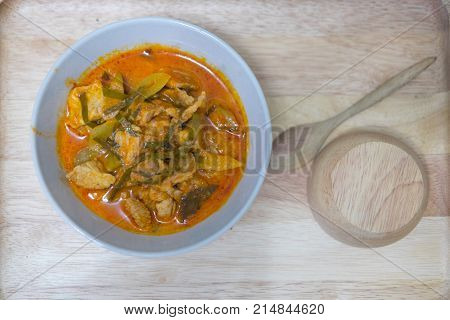 Closeup Panaeng curry with pork or Red curry with pork (Panang pork) on wooden table top view