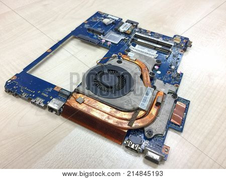 BANGKOK THAILAND - 21 NOV 2017: Main board of old Laptop disassembled for repair on the table