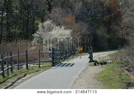 East Providence Rhode Island USA - April 30 2006: Jogger on East Bay Bike Path on early spring day