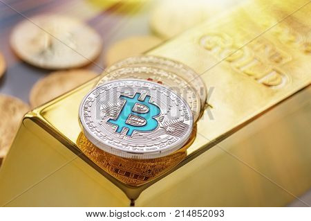 Concept Of Cryptocurrency Physical Bitcoin With Gold Bar And Sunburst Effect