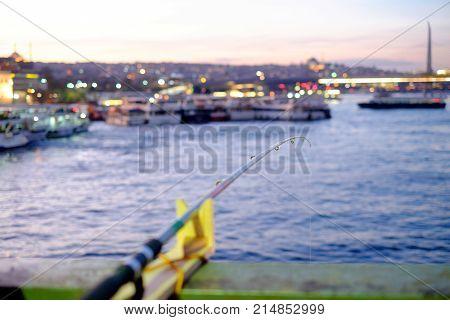 fishing on Galata Bridge, sunset view Istanbul. Selective focus