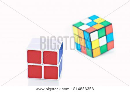 Bangkok, Thailand - November 11, 2017: Rubik's cube two type is good for brain on a white background. Rubik's Cube invented by a Hungarian architect Erno Rubik in 1974.