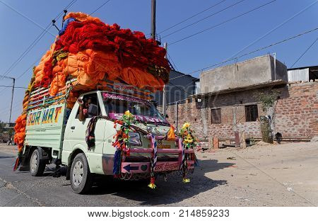 PALI INDIA November 3 2017 : A heavy load of textile on the road. Pali is famous for its textile industries. This is the biggest cotton mill of Rajasthan it employs 3000 workers.