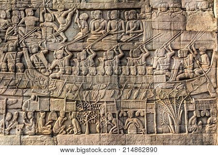 Bas-relief Sculpture at Bayon temple in Angkor Thom Siemreap Cambodia. Angkor Thom is a popular tourist attraction.
