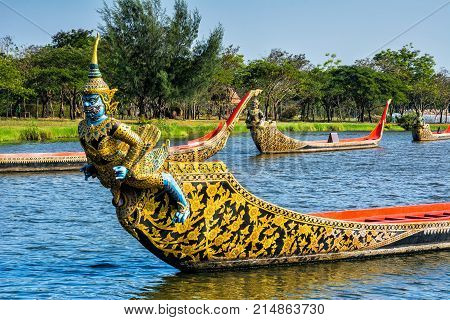 Ancient Siam park Royal Water-Course Procession decorated wooden thai boats on pond closeup. Location: Ancient City Mueang Boran Samut Prakan Province Bangkok Thailand.