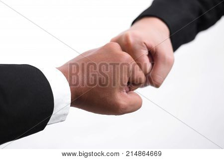 Close Up Of Young Asian Businessman Making A Fist Bump On White Background. Business People Wear Sui