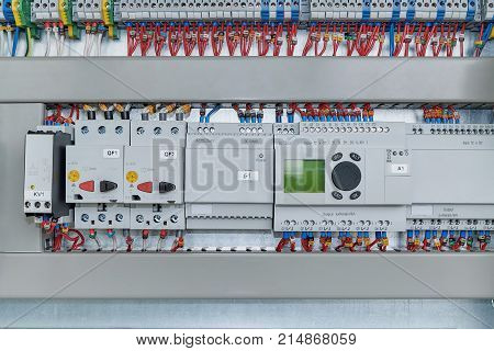 Relays circuit breakers motor protection and controllers extension modules. The number of bushing terminals. Electrical equipment connected by wires to a marking. Controller with LCD screen.