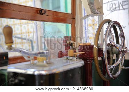 LISBON, PORTUGAL - NOVEMBER 4, 2017: The interior of the funicular Elevador da Lavra in Bairro Alto neighborhood with a close-up on the driver's place