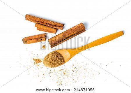 Cinnamon Powder And Sticks Isolated