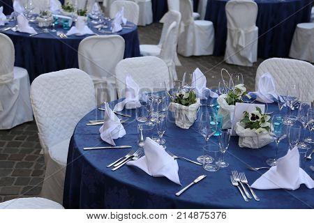 Elegant Table Set With White Chiars