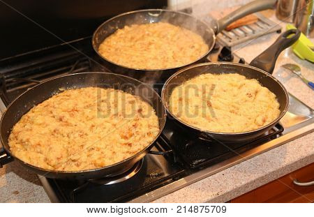 Pans With The Food Named Frico A Typical Italian Dish With Potat