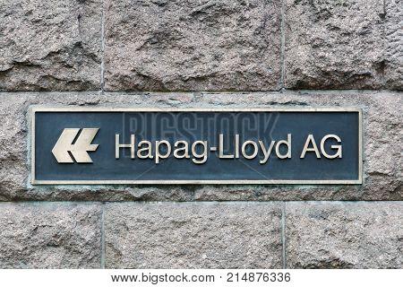 Hamburg, Germany - July 21, 2017: Hapag-Lloyd logo on a wall. Hapag-Lloyd is a multinational German transportation company based in Hamburg, Germany
