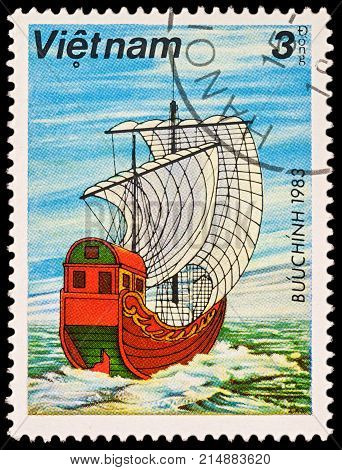 Moscow Russia - November 21 2017: A stamp printed in Vietnam shows old Asian sailing ship - junk with white sails series