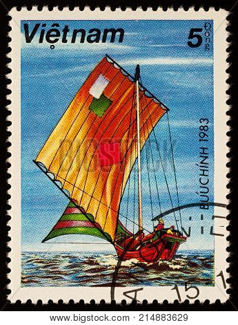 Moscow Russia - November 21 2017: A stamp printed in Vietnam shows old Asian sailing boat with patched sails series