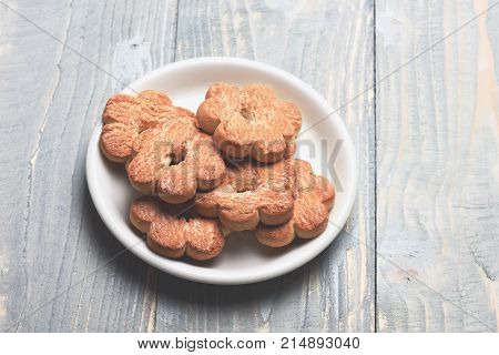 Tea Cookies On Grey Wooden Background. Composition Of Tiny Gateau
