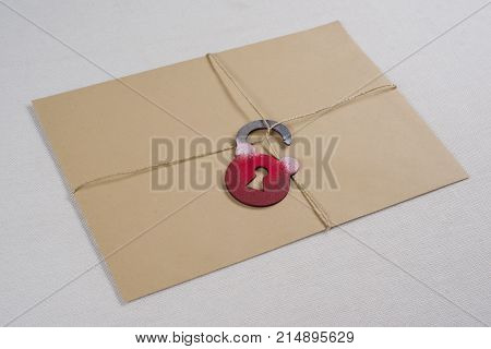A secret envelope a parcel bound with a rope with a symbolic lock. Open the lock. poster