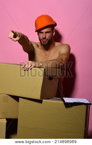 Guy With Sexy Torso Stands Naked Behind Boxes