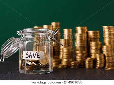 Coins in glass jar, copy space. Money box, saving money for dream, pension, vacation. Financial stability concept