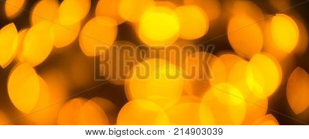 Yellow color light blurred background, unfocused. Christmas or other holiday decorations, garland illumination bokeh