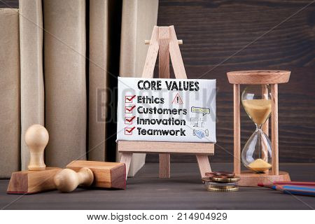 Core Values concept with icons. Sandglass, hourglass or egg timer on wooden table showing the last second or last minute or time out