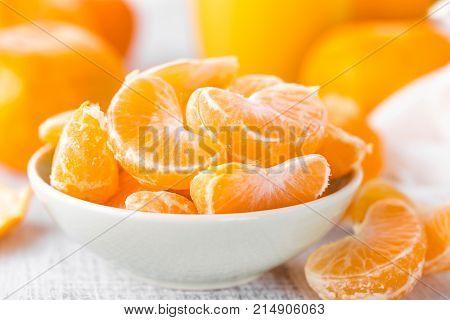 Fresh peeled tangerines on white background closeup, mandarins