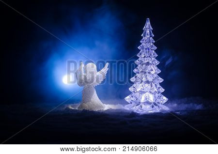 Christmas Angel Glass Xmas Figure And Glass Fir Tree, Christmas Tree, Docorative Elements On Dark Ba