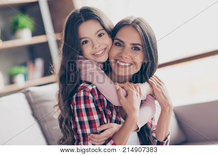 Time Of Tenderness. Beautiful Young Smiling Mum And Her Little Preteen Daughter Are Spending Time To