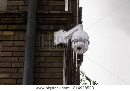 City cctv security camera system attached on the building brick facade