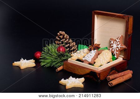Idea DIY Do it yourself new year and Christmas gift concept butter sugar cookies with royal icing decoration in wood box with copy space