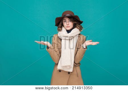 Autumn, Fall Concept. Confusion And Pondering Cute Woman Looking At Camera