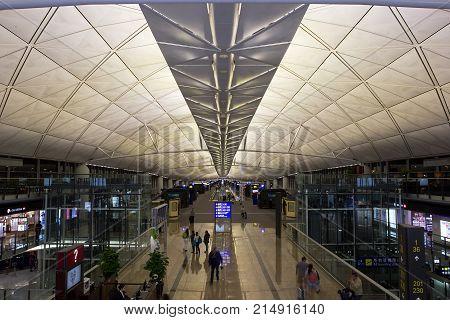 CHEK LAP KOK, HONG KONG - OCT 19, 2017: Passengers make their way towards their departure gate in Chek Lap Kok airport
