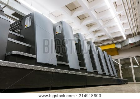Offset Print Machine Units Industrial Room Factory Equipment Cmyk Lithography Engineering Closeup