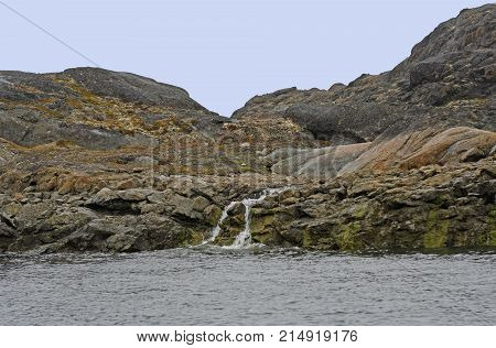 Barren Rock and a Stream in the High Arctic on the Lower Savage Islands on Baffin Island in Nunavut Canada