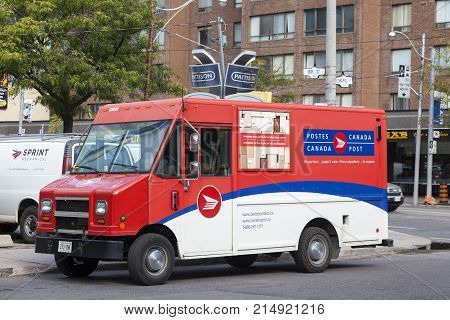 Toronto Canada - Oct 16 2017: Canada Post mail delivery van in the city of Toronto. Province of Ontario Canada